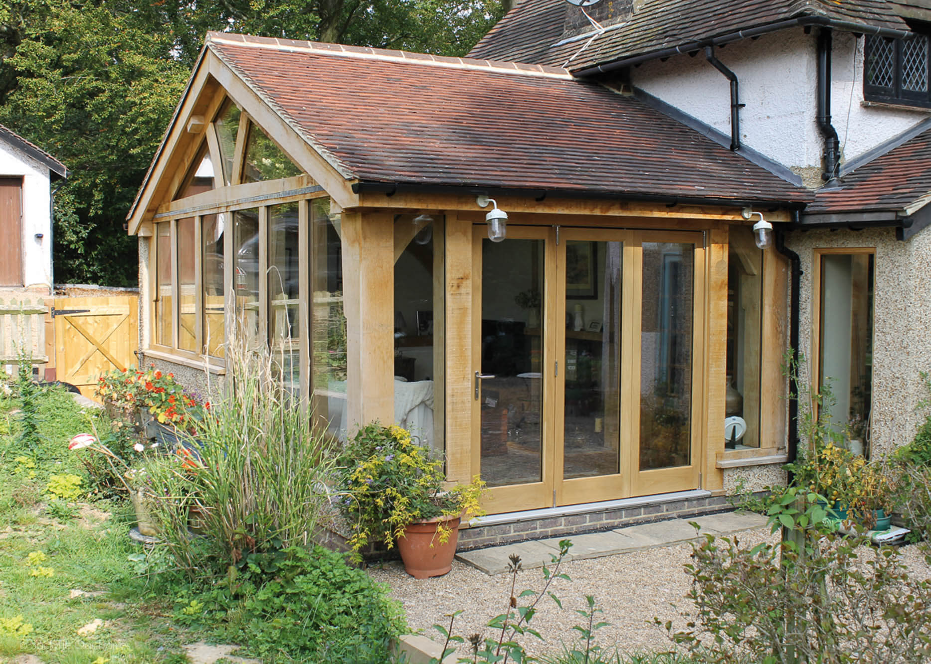 Oak framed extensions garden rooms sackville oak frames for Oak framed garden room